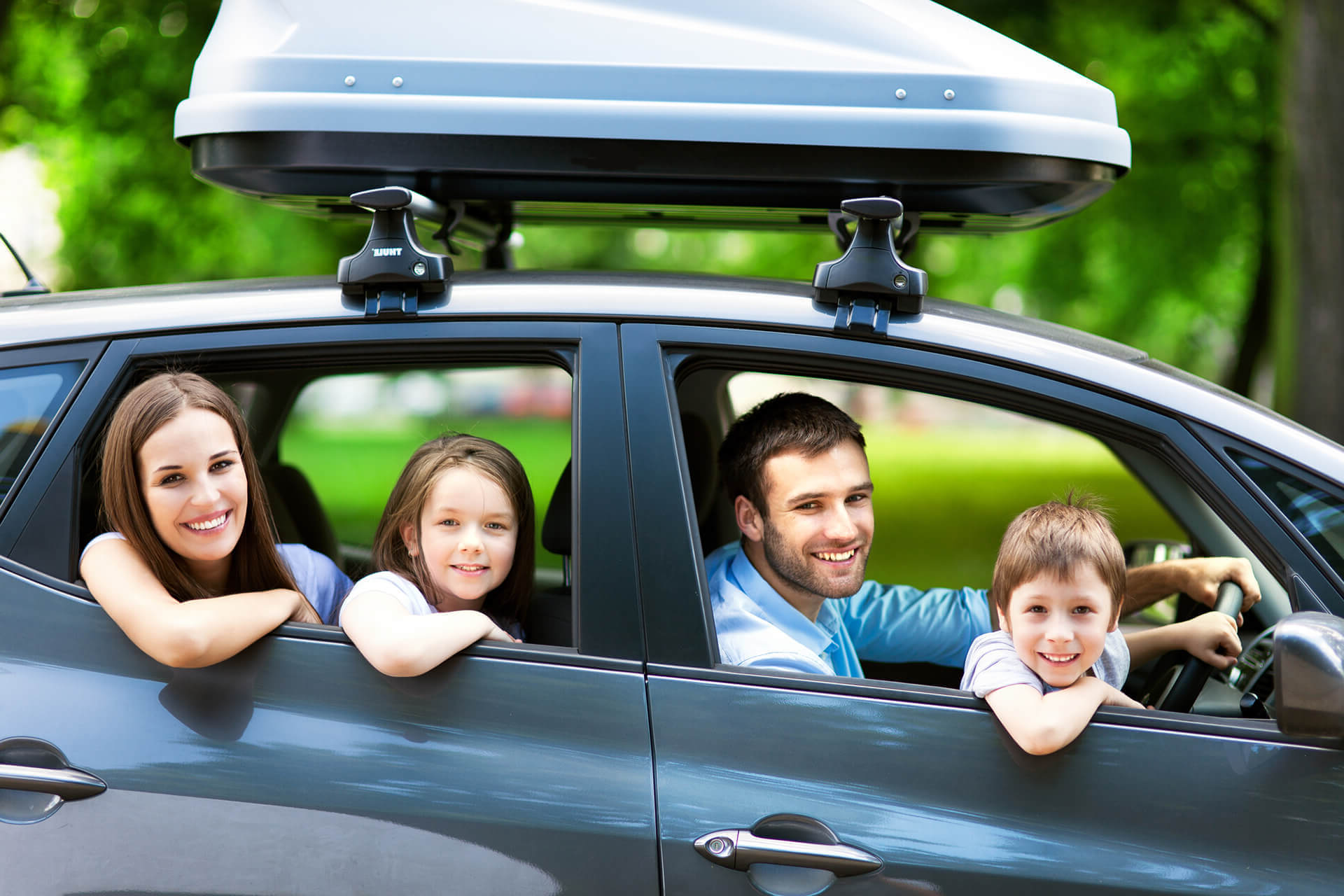 Family posing inside their car